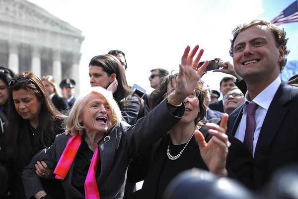 Supporters surround plaintiff Edith Windsor, center, as she leaves the Supreme Court after oral arguments Wednesday over the federal Defense of Marriage Act.