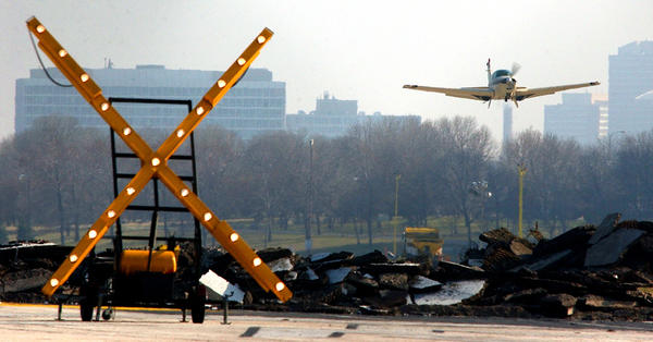 One of the last planes to leave Meigs Field takes off in 2003. Sixteen planes were stranded at Meigs after workers tore up the runway.