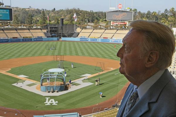 Vin Scully, shown at Dodger Stadium last July, says he won't miss the season opener as he did a year ago with a cold.