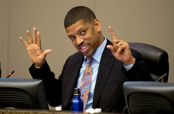 Sacramento Mayor Kevin Johnson counts the votes in favor of the new arena on his fingers during a city council meeting.