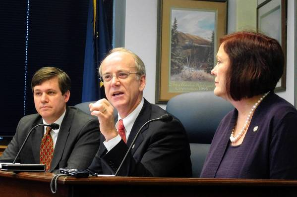 State Sen. Hollis French answers a reporter's question about an oil tax plan put forth by minority Democrats in the Alaska Senate and House. Seated next to French are Sens. Bill Wielechowski and Berta Gardner.