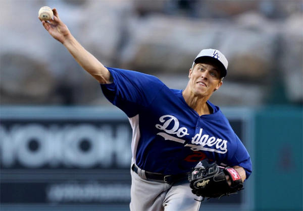 Dodgers starter Zack Greinke delivers a pitch in the first inning against the Angels.