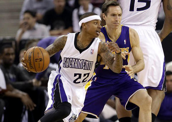 Lakers point guard Steve Nash tries to cut off a drive by Kings point guard Isaiah Thomas in the first quarter Saturday night in Sacramento.