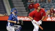 The longest spring in history for both the Dodgers and Angels finally came to a end Saturday at Angel Stadium, and Hank Conger made sure it was an end worth remembering, hitting a two-out, pinch-hit home run off Yimi Garcia to give the Angels a 2-1 victory.