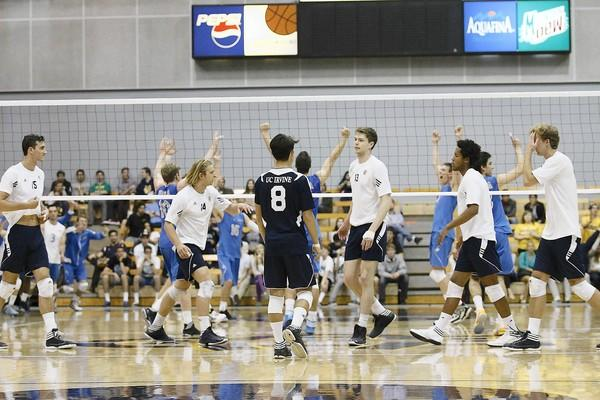 UCLA's men's volleyball team celebrates the final point in a 3-1 win over UC Irvine on Saturday at the Bren Events Center.