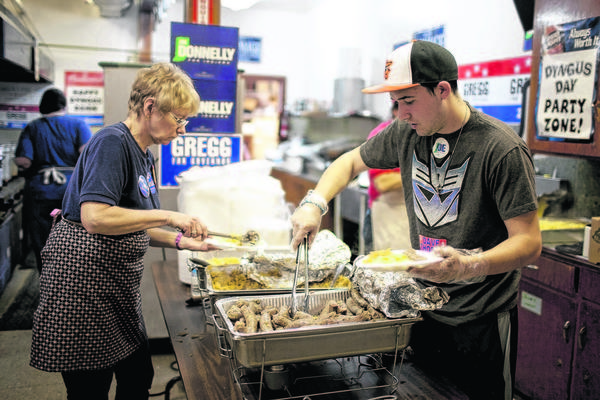 Shotsie Karasiak, left, and Raymond Bakos prepare traditional Polish meals last year on Dyngus Day. Despite no elections taking place in Indiana this year, Dyngus Day is expected to be a lively affair.