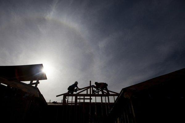 Workers build a home in Rancho Santa Fe.