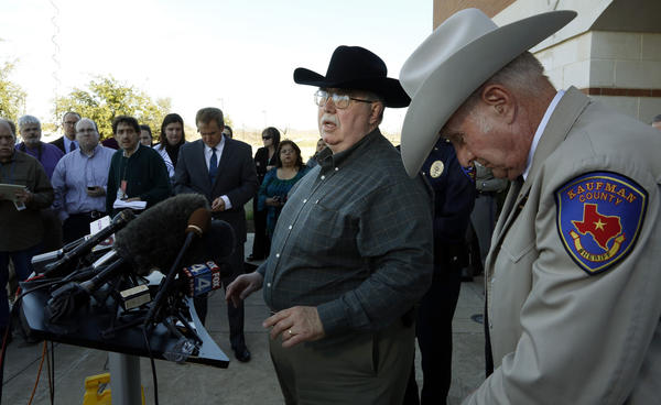 In January, Mike McLelland, district attorney of Kaufman County, meets with reporters to talk about the shooting death of Assistant Dist. Atty. Mark Hasse. At far right is David Byrnes, Kaufman County sheriff. McLelland and his wife were found dead on Saturday, March 30. (Dallas Morning News/MCT)