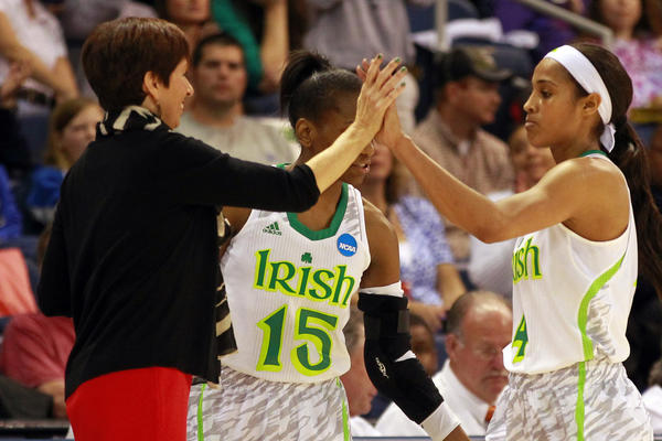 Notre Dame guard Skylar Diggins (4) is congratulated by coach Muffet McGraw after breaking the Fighting Irish all-time scoring record against Kansas.