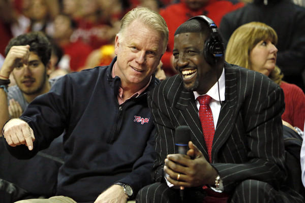Former Maryland basketball star Walt Williams (right) sits with ex-Terp quarterback Boomer Esiason at a game against Duke at Comcast Canter in February. Williams still remembers a tournament at Madison Square Garden in 1990 that helped put him on the map.
