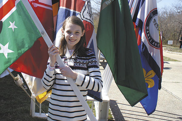 Alli Jacobson holds the Washington County flag, which she was responsible for presenting at the annual Maryland Day flag ceremony.