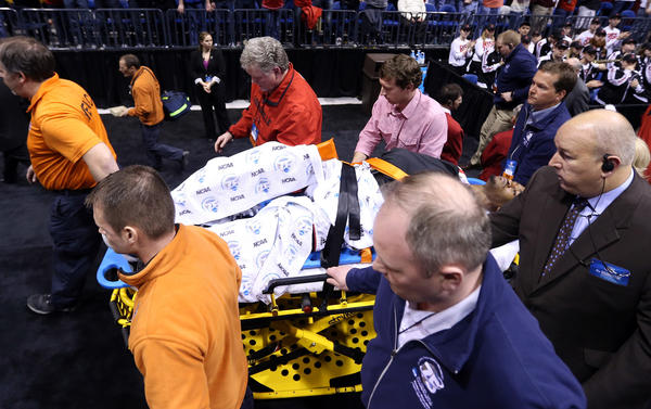 Louisville's Kevin Ware is taken off the court on a backboard after he injured his leg.
