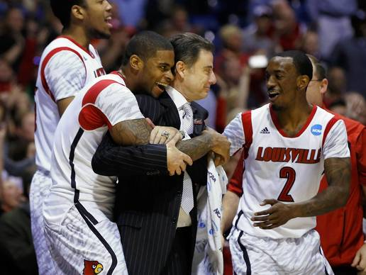 Louisville coach Rick Pitino is hugged by players, including Russ Smith, after defeating Duke.
