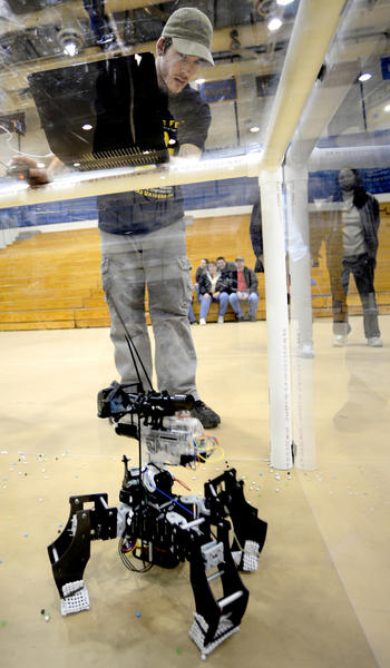 "Shepherd University junior Randy McCright tests ""Tiny"" the robot before sending it into battle Sunday in the Mech-Warfare Arena during the third ShepRobo Fest at Shepherd University."