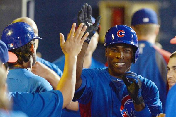 Alfonso Soriano is congratulated after hitting a solo home run during the fourth inning.