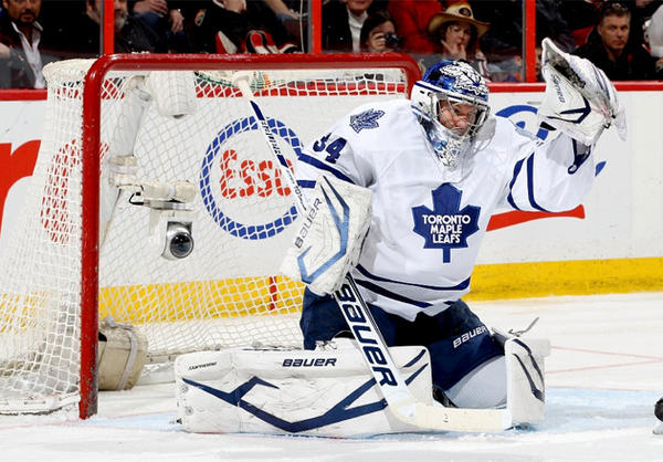 Toronto Maples Leafs goalie James Reimer makes a glove save off a tip during a game against the Ottawa Senators.