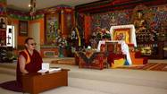Inside the main hall of the Drepung Gomang Institute, gilded statues of Buddha and brilliantly colored images of fierce deities adorn the altar. As the smell of incense wafts through the air, a Tibetan monk chants a sutra, his low tones weaving a soothing, meditative melody.