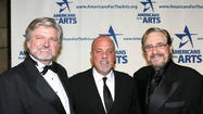 "<span style=""font-size: small;"">Multiple Grammy Award-winning producer Phil Ramone died Saturday at New York Presbyterian Hospital in New York City. He was 79. His son Matt confirmed his father was hospitalized in late February with an aortic aneurysm. Ramone won 14 Grammys and worked with a wide range of artists over his 50 years in the music business, including Ray Charles, Paul Simon, Chicago,Frank Sinatra, Bob Dylan, Billy Joel, Barbra Streisand, The Band, Donny Hathaway, Rod Stewart, Tony Bennett, Kenny Loggins, Barry Manilow, Dionne Warwick, Luciano Pavarotti and Phoebe Snow, among countless others. Ramone's work on Charles' Genius Loves Company, Joel's 52nd Street and Simon's Still Crazy After All These Years helped those collections capture Grammys for Album of the Year. Ramone came to the United States from his native South Africa at the age of 10 to study violin at Julliard. At 18, he opened A&R Recording Studios in New York City.</span>"