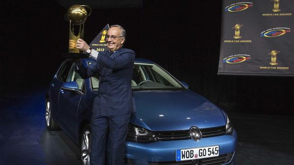 Volkswagen design chief Walter de Silva holds a trophy after the Golf was named 2013 World Car of the Year last week at the New York International Auto Show.
