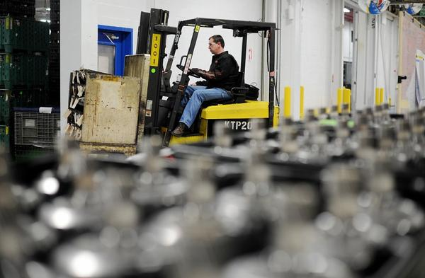An employee operates a fork lift at the Chrysler Group transmission plant in Kokomo, Ind.