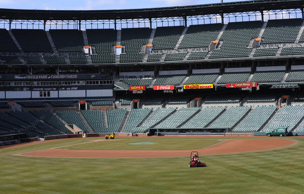 Oriole Park at Camden Yards caretakers prepare for Opening Day on Friday.