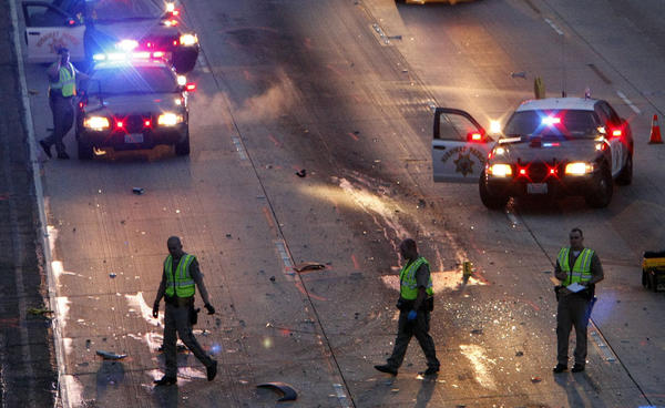 California Highway Patrol officers conduct an investigation into a double-fatality accident on the 118 Freeway in Granada Hills.