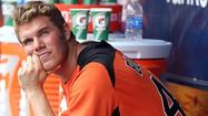 Orioles top prospect Dylan Bundy has been shut down after experiencing some mild elbow tightness in his throwing arm.