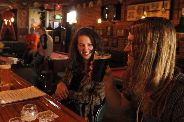 Samantha Cohen and Alex Castle enjoy a cold beer at the Glendale Tap.