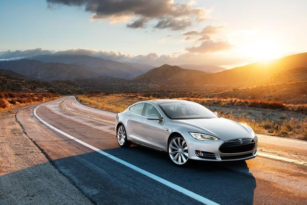 Tesla sales of its Model S electric sedan have exceeded the target that the Palo Alto-based automaker set in February, giving it enough of a boost to claim its first quarterly profit.