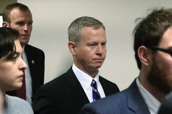 George Brauchler, center, District Attorney in Colorado's 18th Judicial District, arrives at the courtroom for a hearing on Aurora theater shooting suspect James Holmes.