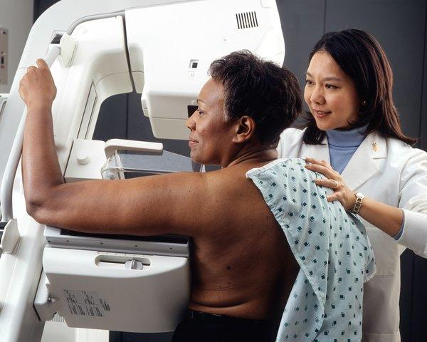 A woman receives a mammogram. On Monday, a U.S. panel updated recommendations on genetic screening for certain mutations in genes that can increase breast and ovarian cancer risk.