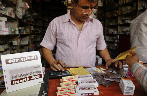 An Indian shopkeeper sells cancer drugs by Indian generic drug manufacturer Cipla in Allahabad, India, on Monday.