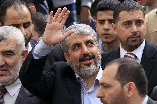 Exiled Hamas leader Khaled Meshaal waves to Palestinian students during his visit to the Islamic University in Gaza City in December.