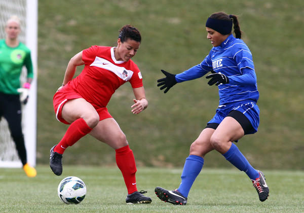 The Washington Spirit's Skyy Anderson pulls the ball away from Duke's Kim DeCesare.