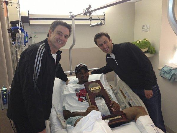 Kevin Ware, shown in the hospital with Louisville Coach Rick Pitino, left, and former assistant coach Richard Pitino, is resting comfortably in an Indianapolis hospital after surgery on his broken leg Sunday night.