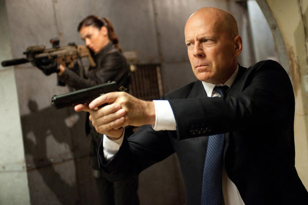 "This film image released by Paramount Pictures shows Adrianne Palicki, left, and Bruce Willis in a scene from ""G.I. Joe: Retaliation."""