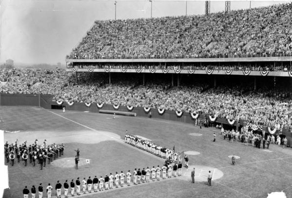The Orioles, Chicago White Sox, and the Army Marching Band mass around home plate for the playing of the National Anthem as Baltimore returns to big league play.