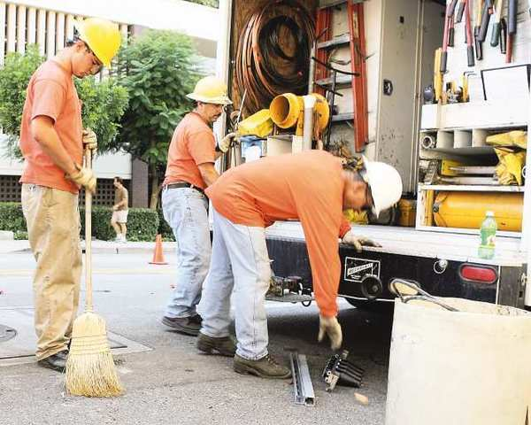Glendale Water & Power workers clean up after installing a new underground transformer.