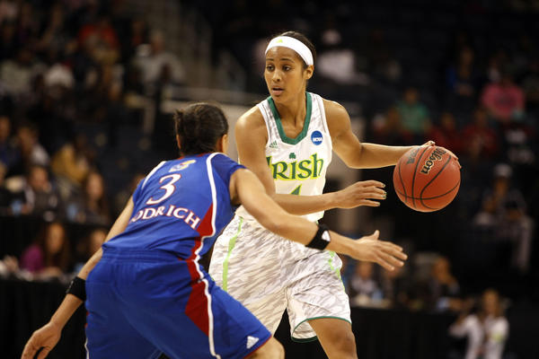 Notre Dame guard Skylar Diggins (4) works against Kansas guard Angel Goodrich (3) during the first half Sunday in Norfolk, Va.