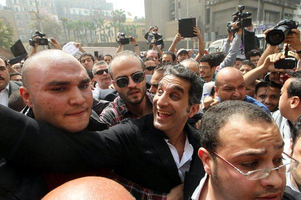 Egyptian TV satirist Bassem Youssef, center, arrives at the high court in Cairo on Sunday.