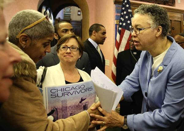 "Cook County Board President Toni Preckwinkle, shown Monday with family of gun violence victims, said the new $25 firearms tax ""is without a doubt a necessary piece of the puzzle"" to reduce such crimes."