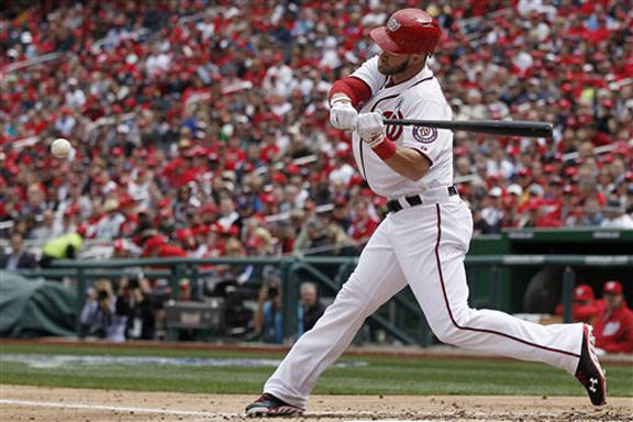Washington Nationals left fielder Bryce Harper (34) hits his second home run of the game in the fourth inning of the opening day baseball game Monday against the Miami Marlins in Washington. Harper's two homers were the lone scores of the game as the Nationals defeated the Marlins, 2-0.