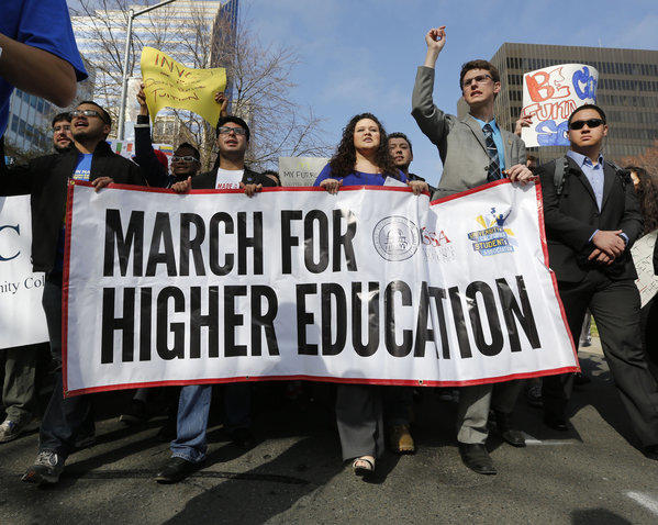 Under-educated Californians could lose out on billions of dollars of income over the next decade, a study estimated. Above, students from around the state march to the state Capitol last month, calling for more funding for higher education.