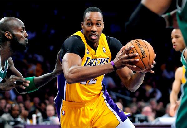 Lakers center Dwight Howard drives to the basket on Celtics' Kevin Garnett.