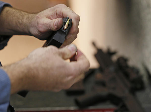 "A man loads a high-capacity magazine for an .223-caliber AR-15 rifle at the ""Get Some Guns & Ammo"" shooting range in January in Salt Lake City."