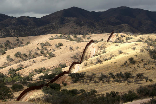The U.S.-Mexico border fence stretches into the countryside on near Nogales, Ariz.