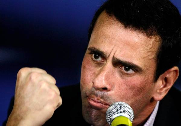 Opposition presidential candidate Henrique Capriles said supporters would hold candlelight marches Tuesday night to demand that the Venezuelan government address rising crime.