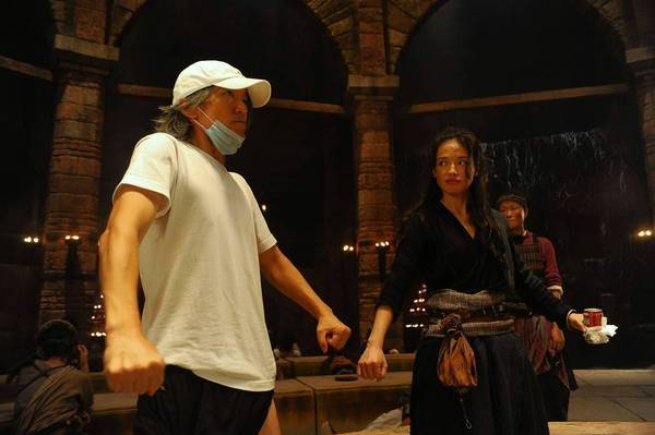 "Stephen Chow (director) and Shu Qi as Miss Duan in ""Journey to the West."""