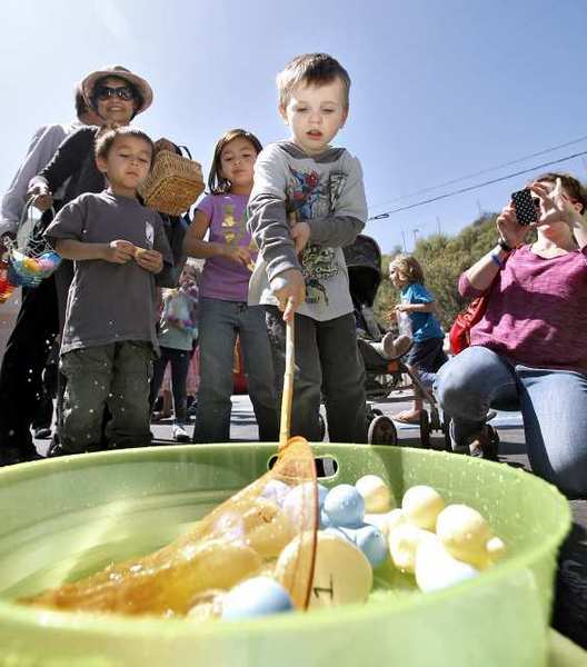 Isacc Porath, 4 of La Crescenta, fishes for ducks and a prize at the Crescenta-Canada Family YMCA's second annual Easter Egg Hunt and Carnival in La Canada Flintridge.