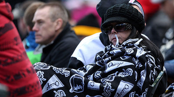 A bundled up Chicago White Sox fan watches the Sox beat the Kansas City Royals on opening day at U.S. Cellular Field.